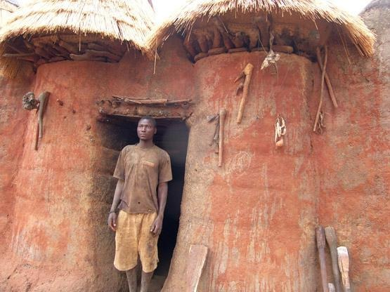 19.Benin_A_Somba_Man_in_the_Doorway_of_his_Tata_photo_JanieBaxter_http-::members.virtualtourist.com:m:pb:1d71e6:
